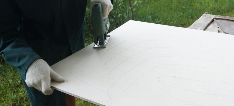 cutting boomerang form from sheet of plywood