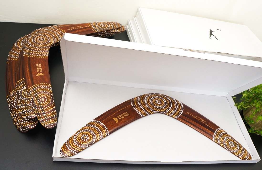 Personalized boomerangs are packed to white gift boxes as coorporate gifts