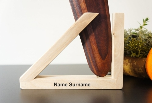 Engraved text on the wooden stand. boomerang holder