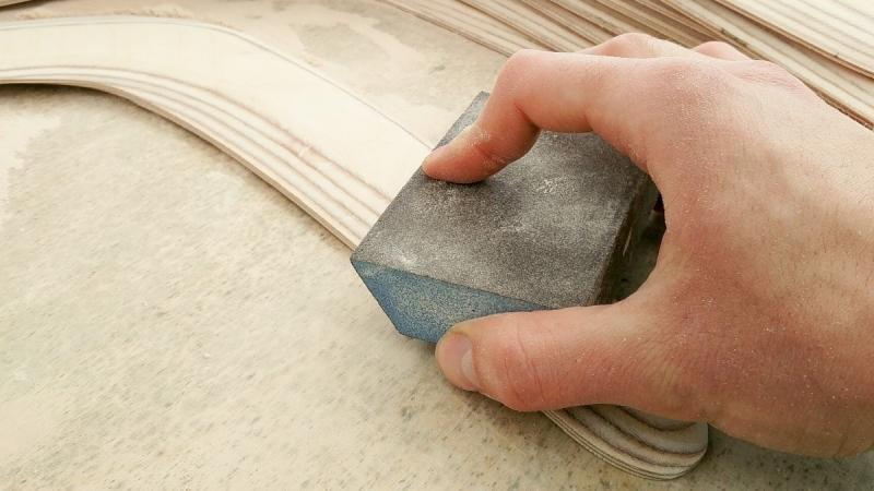 Boomerang sanding smoofly by hand with sanding sponge