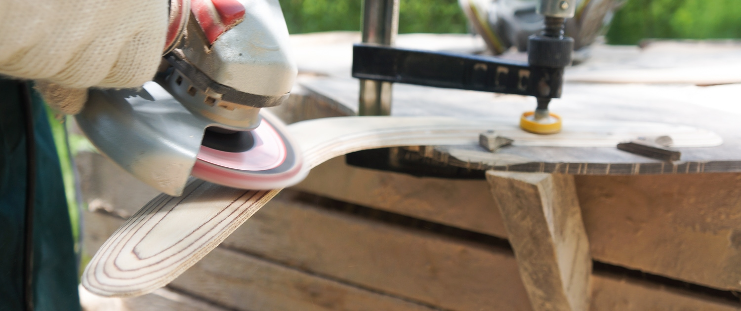Sanding wooden boomerang with Metabo angle grinder