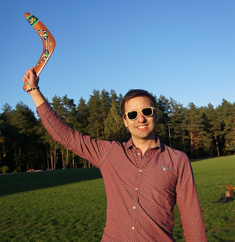 Boomerangs maker with returning boomerang in hand. Craftman