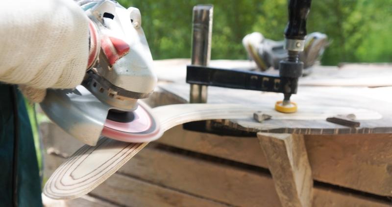 Man use angle grinder. wood sanding